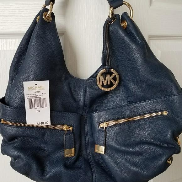 3c78ac8a4 Michael Kors Layton bag with original price tag. Michael Kors.  M_5a6c8376c9fcdf53e9e37354. M_5a6c838184b5ce952a0e99a4.  M_5a6c838f46aa7c313c138909